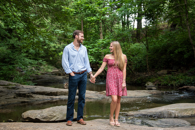 Asheville porposal photographer with couple in creek at Botanical Gardens in Asheville