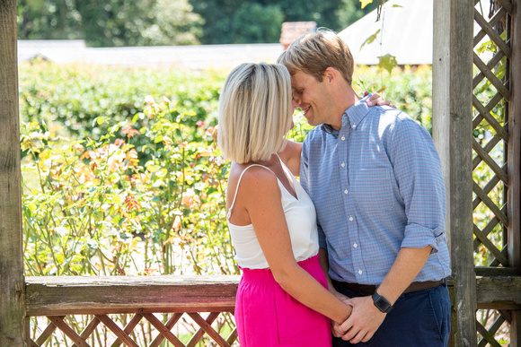 Couple touching noses after proposal at Biltmore Estate