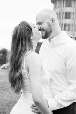 Couple touching noses at Biltmore Estate maternity photo session