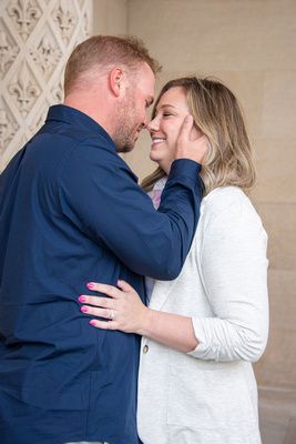 Man holding womans face during engagement photos at Biltmore Estate in Asheville