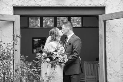 Bride and groom kiss after wedding at West Asheville Tiny Chapel