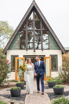 Bride and groom walking during wedding photo at West Asheville Tiny Chapel