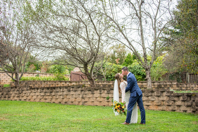 Groom dipping bride at West Asheville Tiny Chapel wedding