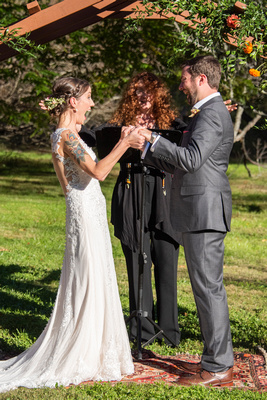 Bride and groom celebrate at wedding ceremony in Asheville