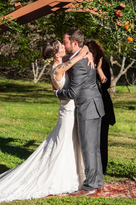 FIrst kiss after wedding ceremony in Asheville at Brahma Ridge Event Center