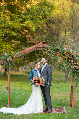 Wedding portrait during fall at Asheville wedding venue with Carolina Flowers arbor