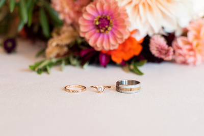 Wedding rings and bouquet in Asheville wedding venue