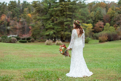 Bridal portrait by lake at Highland Lake Inn near Asheville