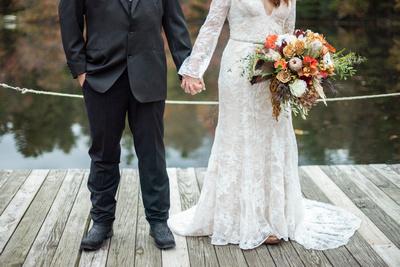 Bride and groom attire at fall Highland Lake Inn wedding