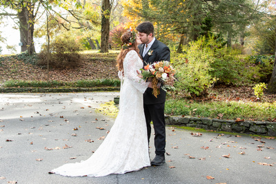 Bride and groom kissing during first look at Highland Lake Inn wedding