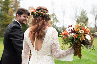 Brides dress with flower crown and bouquet by Flowers by Larry at Highland Lake Inn wedding