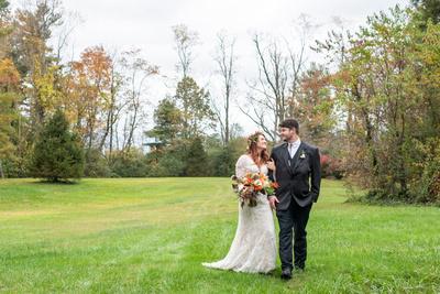 Fall wedding photo in field at Highland Lake Inn