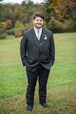 Groom in country tuxedo with bolo tie at Highland Lake Inn wedding near Asheville