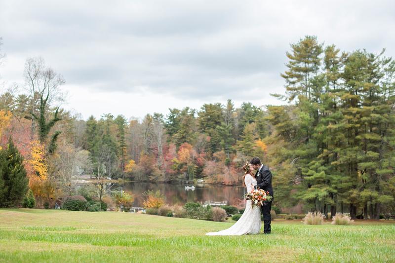 Highland Lake Inn wedding portrait by lake during fall season