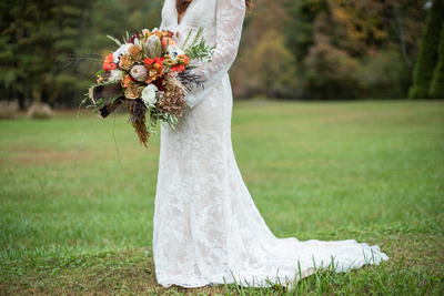 Vera Wang lace wedding gown with fall wedding bouquet at Highland Lake Inn wedding