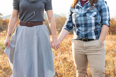 Couple holding hands at Craggy Gardens near Asheville during fall