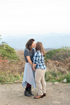 Fall mountain top photo at Craggy Gardens near Asheville of lgbtq couple kissing