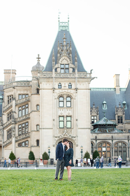 Couple kissing for engagement photos at Biltmore Estate in Asheville