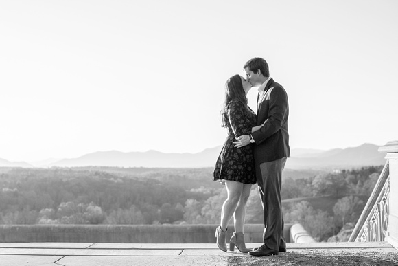 Couple kissing with mountain views during engagement photos at Biltmore Estate in Asheville