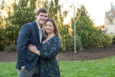 Engagement photo in front of Christmas tree at Biltmore Estate in Asheville