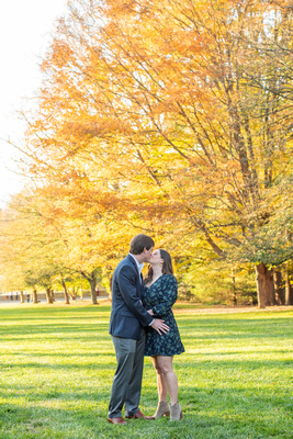 Man and woman kiss during engagement photos at Biltmore Estate in Asheville