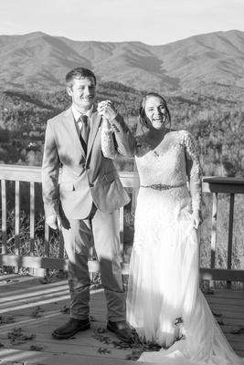 Bride and groom celebrate at wedding ceremony at Hawkesdene wedding near Asheville