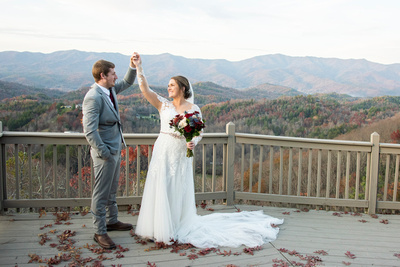 Bride and groom dance on mountain top at Hawkesdene wedding near Asheville