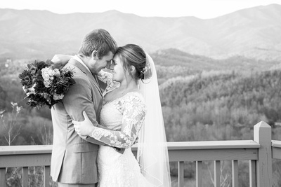 Bride and groom in black and white on mountain top at Hawkesdene wedding near Asheville
