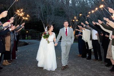 Bride and groom sparkler exit at Hawkesdene wedding near Asheville