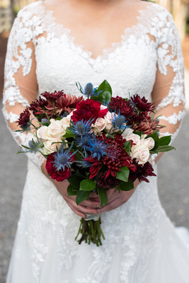 Deep hue fall wedding bouquet by Andrews Florist at Hawkesdene in Andrews NC