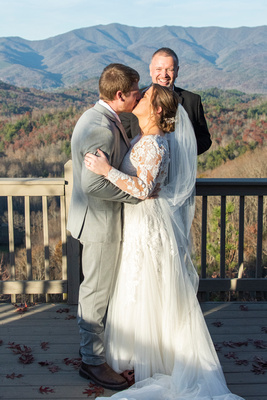 First kiss at wedding ceremony at Hawkesdene wedding near Asheville
