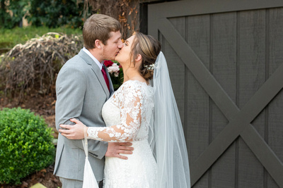 Kiss during wedding first look at Hawkesdene in Andrews NC