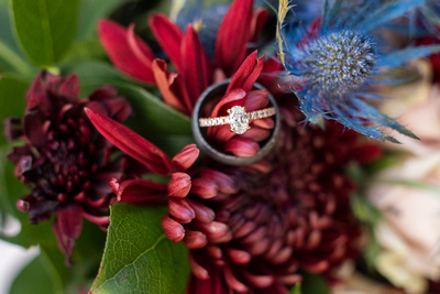 Oval engagement ring with wedding band on bouquest by Andrews Florist at Hawkesdene in Andrews NC