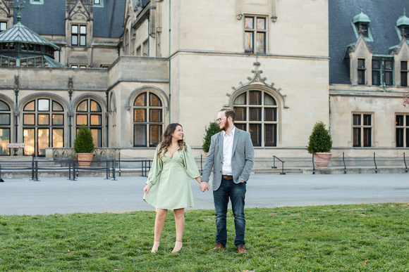 Couple holding hands at Biltmore Estate in Asheville for engagement photos