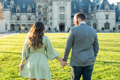 Biltmore Estate engagement photos in Asheville with couple walking away