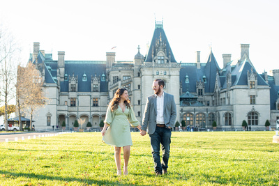 Engagement photos with couple walking at Biltmore Estate