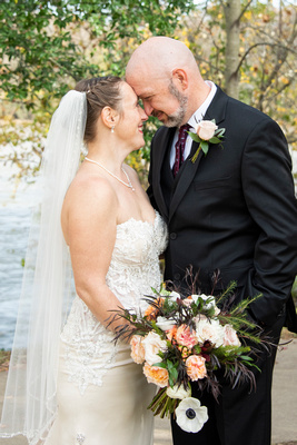 Bride and groom embrace at Stone River in Columbia SC