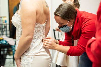 Bride getting in her dress at Stone River in Columbia SC