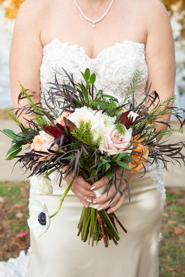 Bride holds wedding bouquet at Stone River in Columbia SC