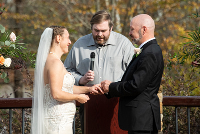 Exchanging rings at wedding ceremony at Stone River in Columbia SC