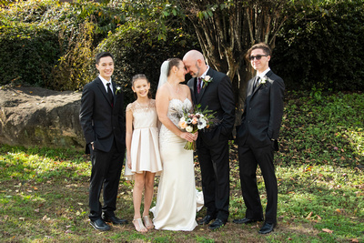 Wedding couple and kids at Stone River in Columbia SC
