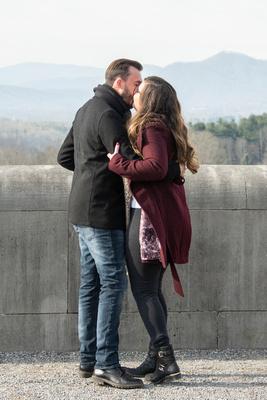 Couple kissing after engagement at Biltmore Estate in Asheville