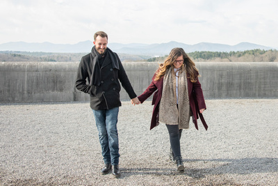 Couple holding hands and walking on south terrace at Biltmore Estate in Asheville