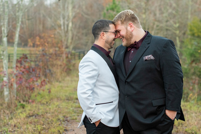 gay couple touching noses near Asheville, NC