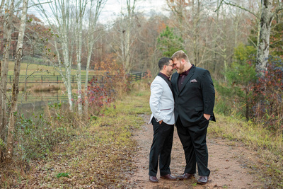 same sex couple touching foreheads after wedding near Asheville, NC