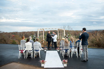 same sex wedding ceremony with rustic decor near Asheville, NC