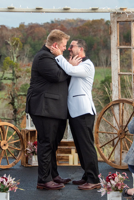 two men excited after wedding ceremony near Asheville, NC
