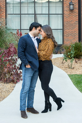 Couple touching noses after engagement at The Foundry hotel in Asheville NC