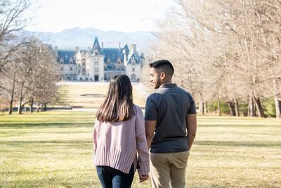 Couple on esplanade after proposal at Biltmore Estate in Asheville