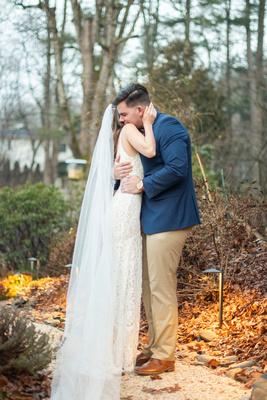 Bride and groom hugging during first look in garden in Hendersonville NC